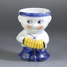 1930s Rocking Egg Cup modelled as a Sailor Boy with Accordian