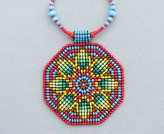 Seed Beaded Mandala, Sacred Geometry Necklace, Mandala Necklace, Native American, Art Jewelry. Green yellof flower on red.