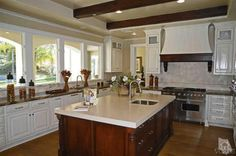 Gourmet kitchen has granite and limestone countertops over custom built cabinetry with Viking appliances including 48 dual oven range and separate Viking wall oven and microwave, built in Subzero refrigerator and two Bosch dishwashers