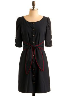 Looks vintage, love the buttons and the red trim.