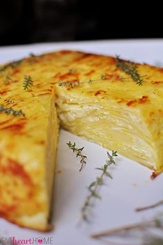 Scalloped Potato Flan with Gruyère and Garlic ~ served overturned and sliced for an elegant presentation