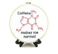 Molecule structure of caffeine in cross stitch in a hoop frame with text caffeine makes me normal