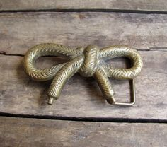 BOW belt buckle.