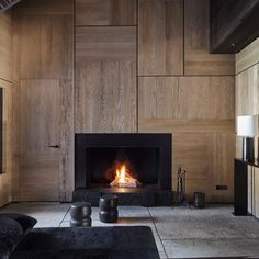Around the fireplace in an interior architecture project in Saint Moritz by Studio Liaigre. Interior Architecture, Home Interior Design, Interior Office, Interior Livingroom, Interior Ideas, New York Penthouse, Living Tv, Christian Liaigre, Timber Panelling