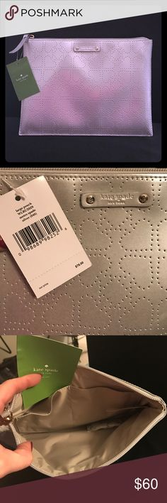 """kate ♠️ Spade pouch Silver polyvinyl brand new with tags """"large pouch"""" metro spade silver in color, could be used as make up bag or clutch or anything really. Super cute! 10"""" x 7"""" make me an offer! kate spade Accessories"""
