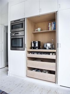 love the microwave/oven wall unit and the storage/coffee cabinet that opens up with doors sliding back into cabinet