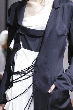 Asymmetric blazer loosely fastened with laces; layered fashion details // Yohji Yamamoto S/S 2015