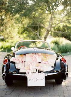 The ultimate getaway car! Click to see more! | Photography: Jose Villa - josevillaphoto.com Floral Design: Mindy Rice - mindyrice.com Calligraphy: Laura Hooper - lhcalligraphy.com   Read More on SMP: http://stylemepretty.com/vault/gallery/2268