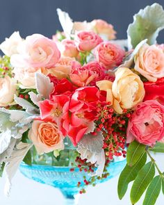 Kiana Underwood of Tulipina shares how to create this romantic-looking centerpiece featuring pepper berries, spray roses, and godetias.