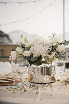 *May wedding, but white flowers are so nice 21 Winter Decor Ideas That Don't Scream Christmas A Practical Wedding: Blog Ideas for the Modern Wedding, Plus Marriage