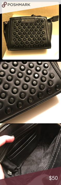 Michael Kors Studded Leather Crossbody Michael Kors Studded Crossbody. Worn only on vacations. Shows signs of wear and are pictured. PERFECT INSIDE CONDITION. Has built in credit card holder. Comes from smoke free home. No receipt. No tags. Can include dust bag. MICHAEL Michael Kors Bags Crossbody Bags