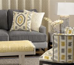 Marvelous Grey Color Scheme Interior Design Idea For Living Room With Gray Sofa With Cream Cushion With Gray Motive White Orchid Yellow Pouffe