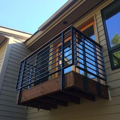 Fully TIG welded exterior guard rails are up! solid Ipe hardwood handrail, mortised into the topcap. House With Balcony, Modern Balcony, Porch And Balcony, Iron Balcony, Deck Balustrade Ideas, Balustrade Balcon, Deck Railings, Railing Ideas, Balcony Grill Design