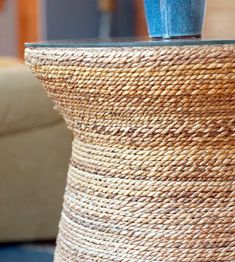 Nautical Rope Side Table... Shop the Look or DIY: http://www.completely-coastal.com/2015/07/blue-coastal-living-room-sea-life-rug-drawer-chest.html