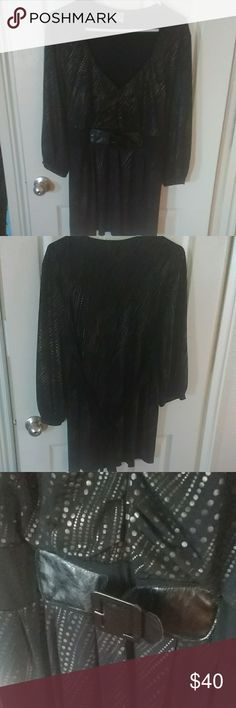 Black polk a dot top EUC.... One of my favorites this top is black with glodish copper design. Faux belt at waist and tie back lots of stretch and is a longer top this top has no size but can fit a 2x to 3x. Pair with black jeans and boots or a skirt and heels and feel absolutely beautiful Tops Tunics