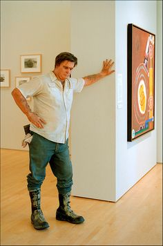 Duane Hanson work at Stanford's Cantor Museum. No, it's not a person, it's a sculpture.