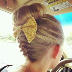 upside down french braid with a bow and sock bun! That is so cute