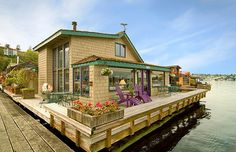omg-  a HOUSE boat. i want. to live. here. happily ever after