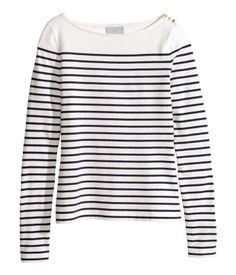 Long-sleeved jersey top with a boat neckline. Decorative buttons at one shoulder and at cuffs.