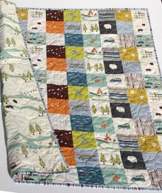 This modern baby quilt was created using Camp Sur by Jay Cyn Designs for Birch Organic Fabrics which is 100% GOTS certified organic cotton. This quilt is a wholecloth quilt and the patchwork pattern i