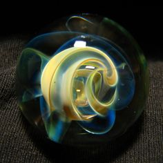 This is a glass marble made by me, Andrew Groner, using borosilicate glass.  It measures approximately. 1 1/4        Signed AJG 14.    I have been