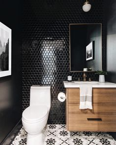 Looking at our recent pictures, we've been sharing a lot of bright white spaces with you guys so for this throwback we're throwing in a dark drama repost of this powder room we designed for the Richcraft Bowery sales centre last year!