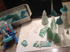 """This shows the green royal icing trees (waffle cones) in the foreground.  Background trees have white royal """"snow"""" piped over the dried green trees."""