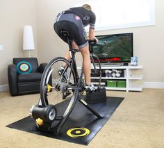 The Pros and Cons of Turbo Trainers and Using Zwift Zwift Cycling, Indoor Cycling, Cycling Equipment, Bike Rollers, Indoor Bike Rack, Cycle Trainer, Roller Workout, Indoor Bike Trainer, Bike Room