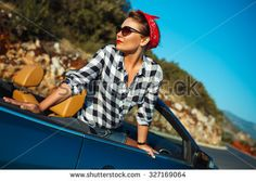 Beautiful pin up woman sitting in cabriolet, enjoying trip on luxury modern car with open roof, fashionable lifestyle concept - stock photo