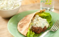 Raita, a cool cucumber and yogurt sauce, makes an ideal complement to warmly spiced lamb burgers. Just need to substitute the whole wheat pitas for gluten free ones. Lamb Burger Recipes, Meat Recipes, Whole Food Recipes, Cooking Recipes, Lamb Recipes, Lamb Skewers, Lamb Burgers, Cucumber Recipes, Health
