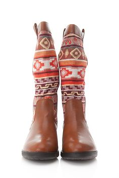 check out the bohemian vibe! This stellar calf boot features a padded insole, tribal print, vegan leather round toe front, side hoops, bottom grip sole, and chunk heel. This boot is perfect to add with your favorite shorts or loose skater dress.  Find it at www.cicihot.com #Welovefashion #Worldoffashion #Fashionlovers #Fashiongods #BeHot #Nightout #Classy #Class #HighFashion #CiciHot #FollowUs #RepinUs #CheckUsOut