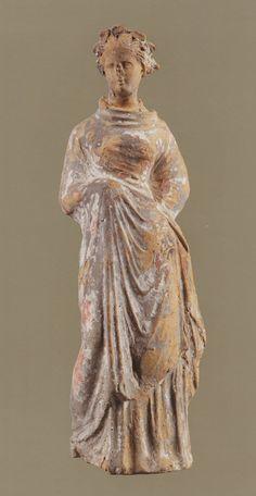Tanagra figurine of a Standing WomanCyrenaicaThird Century B.C.