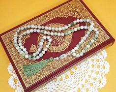 Islamic prayer beads that make great gifts for Ramadan! This 99 bead Peace Jade Muslim tasbih solves your gift giving problem! Click to visit my Etsy shop for dozens more styles! Islamic Prayer, Islamic Gifts, Tassel Jewelry, Etsy Jewelry, Unique Gifts, Handmade Gifts, Prayer Beads, Custom Labels, How To Make Beads