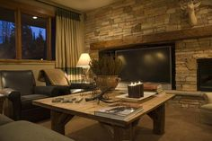 Pretty flat screen/fireplace wall! Really like the overall scheme of the room also.