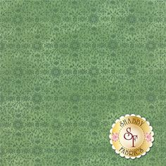"""Evergreen 30405-20 Holly by Moda Fabrics: Evergreen is a collection by BasicGrey for Moda Fabrics. This fabric features a tonal green snowflake and floral design on a green background. Width: 43""""/44""""Material: 100% CottonSwatch Size: 6"""" x 6"""" Expected Arrival Date Is May 2015"""