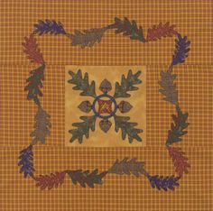 Don't be afraid to choose a strong print or plaid as an appliqué foundation. Here, appliqués in the rich colors hold their own against a prominent gold-and-red homespun background