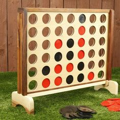 Giant version of the classic game. Giant 4 In A Row is a 3 foot by 2 foot game face made out of English Ash and Mango woods. This oversized game