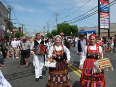 Portuguese Folkloric Costume from Minho, Portugal. The girls in the front are in the Domingar costume. I love the burgundy color of the costume on the left!