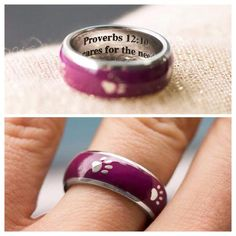 "Designed exclusively for The Animal Rescue Site, our stainless steel ring combines your love for animals with the solemn words of Proverbs 12:10. A parade of silver paws within a purple border decorates the surface. Inside bears the inscription, ""A righteous man cares for the needs of his animals."""