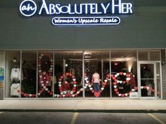 Don't you love it... look closer: The shopkeeper says: Valentine's Day Window Display.  Each heart has something written on it by one of our customers.