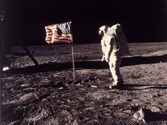 """Astronaut Edwin E. """"Buzz"""" Aldrin Jr. posing for a photograph beside the U.S. flag deployed on the moon during the Apollo 11 mission, 45 years ago."""