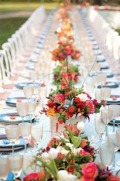 Line a long table with bold potted flowers.Photo Credit: Shawna Yarbrough