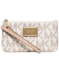 Ideal for day, glamorous at night. Michael Michael Kors's compact wristlet is a versatile option for hauling just the essentials. | MK Signature PVC; lining: polyester | Imported | Medium sized bag; 7