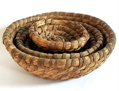 This graduated set of 3, most likely from the Northeastern Pennsylvania region, were hand-coiled and woven from rye straw, held by flexible oak strips. Looking good with natural aged darkening, this set nests within each other in three sizes. Lovely set in a rustic home or cabin setting. Nests, Rye, Accent Pieces, Pennsylvania, Decorative Bowls, Household, Rustic, Matching Set, Natural