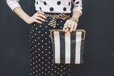 black and white stripes and dots mixed into one outfit
