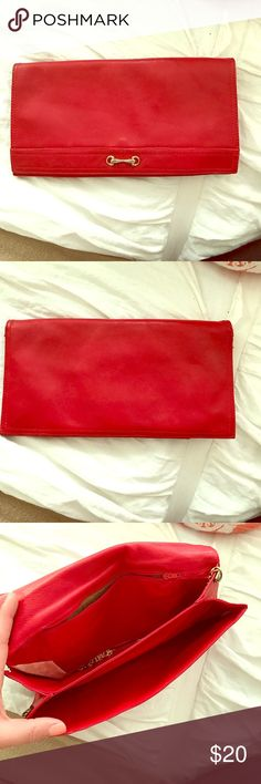 Red Clutch This red clutch has an Hermes like detail on the exterior.  The exterior of the clutch is flawless but the interior has ripped inside of one of the two pockets.  The chain also broke but that can easily be replaced. Bags Clutches & Wristlets