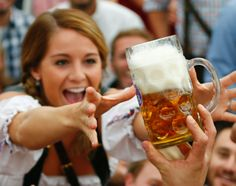 Oktoberfest 2013: Revelers celebrate at annual beer festival in Munich. Bottoms up! Oktoberfest is coming to a close, but the fun isn't over yet. Check out these revelers having a blast at the 180th anniversary of the autumn beer festival in Munich. Here, a young woman in a dirndl gets grabby with a mug of beer from the first barrel tapped at the festival.