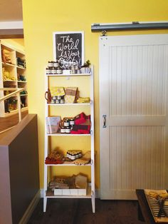 barn door installation   yellow wall   Bed & Butter in #AnnArbor, Michigan