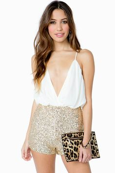 A glitzy nighttime romper featuring a chiffon bodice and a metallic sequined shorts. Surplice neck. Adjustable spaghetti straps. Open crisscross back with a concealed hook-eye and zip closure. Finished leg openings. Full lining.