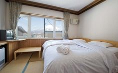 Slowlife Niseko has a happy communal lodge vibe while rooms offer a private retreat. #niseko #chalet #mtyotei #bedroom